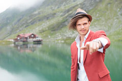 Young casual man pointing his finger near lake Stock Photography
