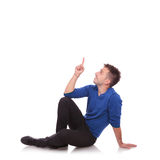 Young casual man pointing up Royalty Free Stock Photography