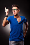 Young casual man pointing upwards Stock Photos