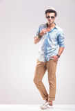 Young casual man posing on grey studio backgroud Royalty Free Stock Photos
