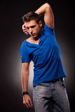 Young casual man posing with hand above his head Royalty Free Stock Photos