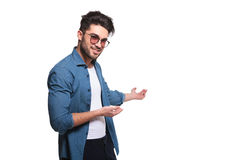 Young casual man presenting Stock Image