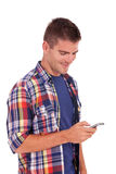 Young casual man reading an sms Royalty Free Stock Photo