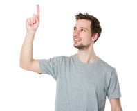 Young casual man selecting or pushing a button Royalty Free Stock Images