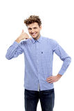 Young casual man showing call me gesture Stock Photo