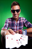 Young casual man showing his poker hand Stock Photo