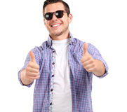 Young casual man showing the thumb up gesture Royalty Free Stock Photo