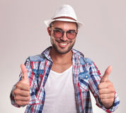 Young casual man showing the thumbs up gesture. Royalty Free Stock Photography