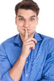 Young casual man showing you to be silent. Royalty Free Stock Photo