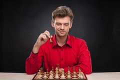 Young casual man sitting over chess. Stock Photo