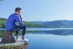 Pensive man by the lake Royalty Free Stock Images