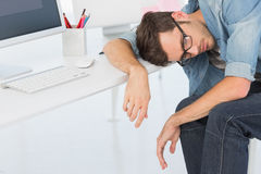 Young casual man sleeping in front of computer Stock Photo