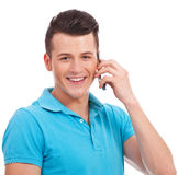 Young casual man speaking on cellphone Stock Photos