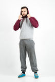 Young casual man in sportswear holding hoodie Stock Photo