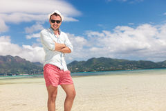 Young casual man standing on the beach Stock Image