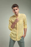 Young casual man standing on studio background Stock Photo