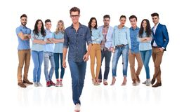Young casual man stepping in front of his group. Young casual men with glasses stepping in front of his group on white background stock photography