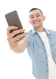 Young casual man taking selfie photo using mobilephone Stock Images