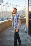Young casual man talking by mobile phone outdoor Stock Photos