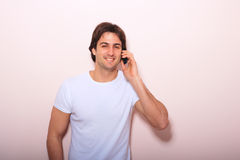 Young casual man talking on the phone Stock Images