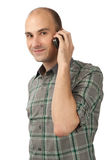 Young casual man talking on the phone Royalty Free Stock Image