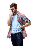 Young casual man thinking Royalty Free Stock Images