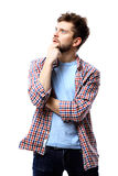 Young casual man thinking Stock Images