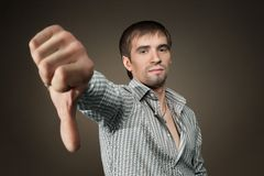 Young casual man thumb down Royalty Free Stock Photo