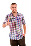 Young casual man thumb up Stock Photo