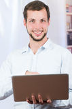 Young casual man using laptop Royalty Free Stock Images