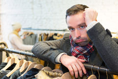 Young casual man waiting while his wife's shopping Royalty Free Stock Photography