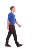 Young casual man walking forward Royalty Free Stock Image