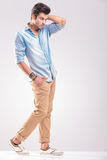Young casual man walking on grey studio background Stock Image