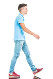 Young casual man walking on isolated background. Royalty Free Stock Photos