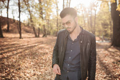 Young casual man walking in the park Royalty Free Stock Images