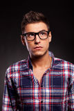 Young casual man wearing glasses and looking up Stock Photography