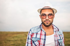 Young casual man wearing hat and glasses Stock Image