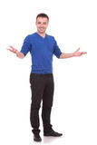 Young casual man welcoming you Royalty Free Stock Images