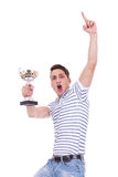 Young casual man winning a trophy Royalty Free Stock Photo