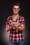 Young casual man working on a tablet Stock Images