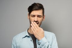 Young casual man yawning Stock Images