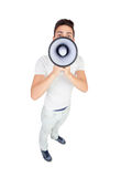 Young casual men with a megaphone Stock Images