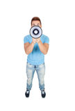 Young casual men with a megaphone Royalty Free Stock Photos