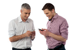 Young casual men using their smart phone Stock Photography