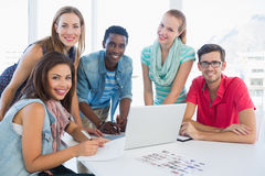 Young casual people using laptop in office Royalty Free Stock Image