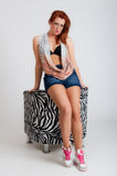 Young casual red haired female and chair Stock Photo