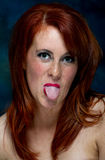 Young casual red haired female portrait pulling a face Stock Image