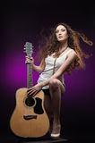 Sexy girl holding guitar Royalty Free Stock Photos