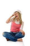 Young casual smiling woman in white hat Stock Images