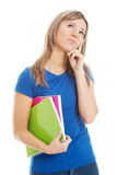 Young casual student holding workbook and thinking. Stock Image